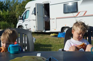 Andy's children sitting outside their motorhome