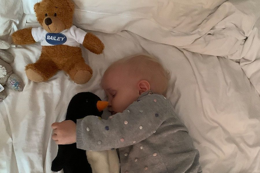 Toddler napping in motorhome with Bailey Bear